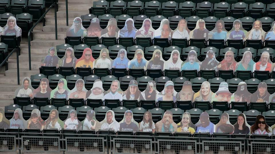 Mandatory Credit: Photo by Ted S Warren/AP/Shutterstock (10733024x)Photos of fans are displayed in seats at T-Mobile Park during the Seattle Mariners' home opener baseball game against the Oakland Athletics due to the coronavirus, in SeattleAthletics Mariners Baseball, Seattle, United States - 31 Jul 2020.