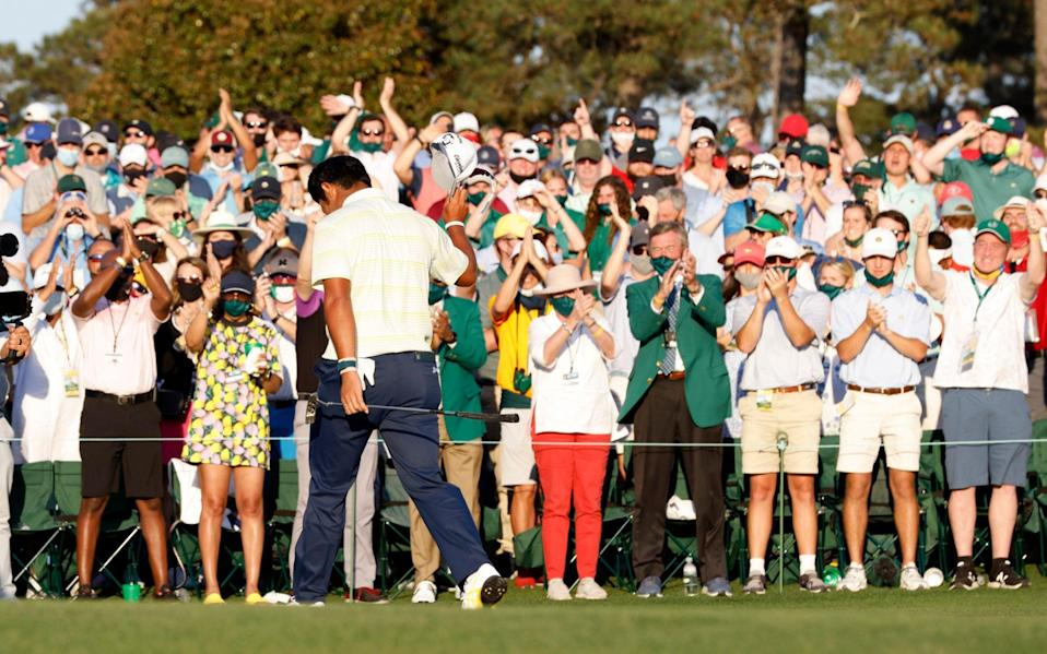 Japan's Hideki Matsuyama celebrates on the 18th green after winning The Masters - Reuters