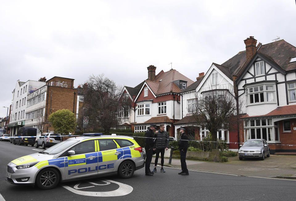 FILE - In this Monday Feb. 3, 2020 file photo, police officers block a road leading to the scene of Sunday's terror stabbing attack in the Streatham area of south London. A jury in London on Friday, Aug. 20, 2021 has concluded that a terror attack in the south of the city last year could have been prevented had the perpetrator been recalled to prison after he bought items that were used in a fake suicide belt. Twenty-year-old Sudesh Amman was shot dead by armed undercover officers after he stole a knife from a hardware shop and randomly stabbed a man and a woman in Streatham on Feb. 2, 2020, before turning to charge at the two armed police officers who gave chase. (AP Photo/Alberto Pezzali, file)