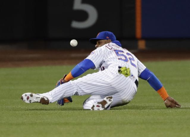 Yoenis Cespedes left Thursday's game against the Philadelphia Phillies in the sixth inning with a hamstring injury (AP Photo/Frank Franklin II).