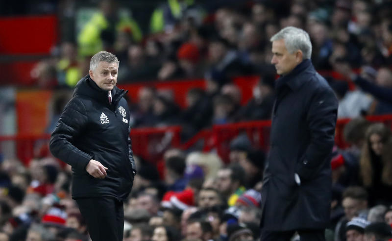 Manchester United manager Ole Gunnar Solskjaer (left) and Tottenham Hotspur manager Jose Mourinho during the Premier League match at Old Trafford, Manchester. (Photo by Martin Rickett/PA Images via Getty Images)