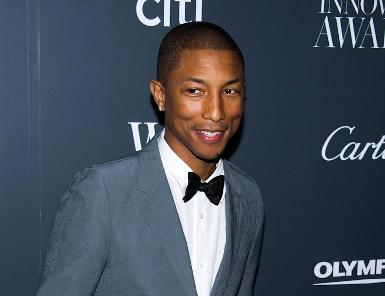 """FILE - In this Nov. 6, 2013 file photo, Pharrell Williams attends the WSJ. Magazine's Innovator Awards in New York. This week Pharrell released his sophomore solo album, """"G I R L,"""" which features the Oscar-nominated hit, """"Happy."""" The song is spending its second week on top of the Billboard Hot 100 chart. (Photo by Charles Sykes/Invision/AP, File)"""
