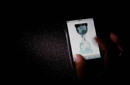FILE PHOTO: Logo of the Wikileaks website is pictured on a smartphone in Tokyo