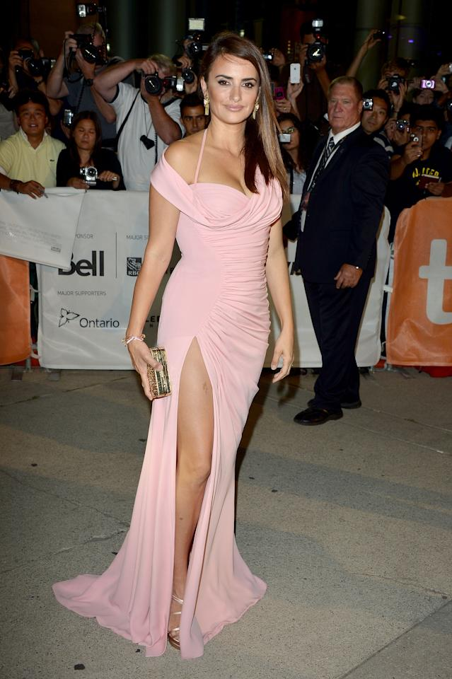 """BEST: Penelope Cruz's pink Versace gown was the hit of the """"Twice Born"""" premiere. With her hair straight and sleek, Cruz showed off both her cleavage and her well-toned legs, but did so in a way that was still beautiful and classy."""