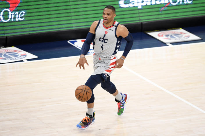 Washington Wizards guard Russell Westbrook dribbles the ball during the first half of an NBA basketball game against the Charlotte Hornets, Sunday, May 16, 2021, in Washington. (AP Photo/Nick Wass)