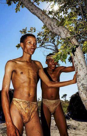 Two San bushmen are shown prior to a study in Tsumkwe, Namibia, in this undated handout provided by Cell Press October 15, 2015. REUTERS/Josh Davimes/Handout via Reuters