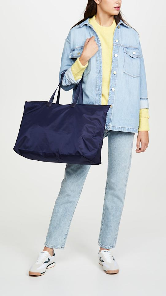"<p>This <a href=""https://www.popsugar.com/buy/Tumi-Just-Case-Tote-541842?p_name=%20Tumi%20Just%20in%20Case%20Tote&retailer=shopbop.com&pid=541842&price=100&evar1=fab%3Auk&evar9=44447011&evar98=https%3A%2F%2Fwww.popsugar.com%2Ffashion%2Fphoto-gallery%2F44447011%2Fimage%2F47129202%2FTumi-Just-in-Case-Tote&list1=shopping%2Cluggage%2Csuitcases%2Ctravel%20style%2Ctravel%20goods&prop13=api&pdata=1"" rel=""nofollow"" data-shoppable-link=""1"" target=""_blank"" class=""ga-track"" data-ga-category=""Related"" data-ga-label=""https://www.shopbop.com/tumi-voyageur-just-case-tote/vp/v=1/1514600377.htm?fm=search-viewall&amp;os=false&amp;ref=SB_PLP_NB_64"" data-ga-action=""In-Line Links""> Tumi Just in Case Tote </a> ($100) is foldable, so you can take it with you in your suitcase and then stuff it up on the way back.</p>"