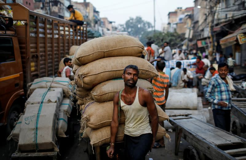 Bruised Indian economy to be battered further by coronavirus: Reuters poll