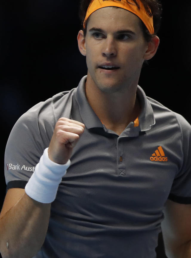 Austria's Dominic Thiem celebrates after defeating Switzerland's Roger Federer in their ATP World Tour Finals singles tennis match at the O2 Arena in London, Sunday, Nov. 10, 2019. (AP Photo/Alastair Grant)