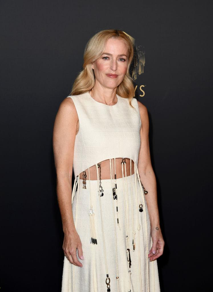 Gillian Anderson looked ageless in a boho-inspired dress which highlighted her toned stomach. (Getty Images)