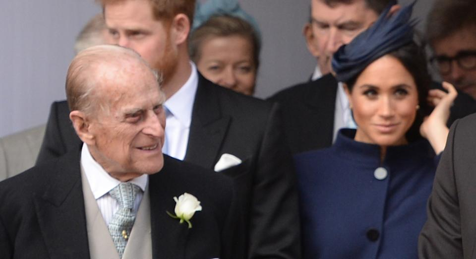 Prince  Philip with Prince Harry and Duchess Meghan sitting behind him