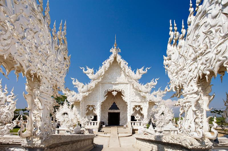 """Thailand's Wat Rong Khun, or White Temple, attracts thousands of tourists every year with its intricate carvings depicting <a href=""""http://www.atlasobscura.com/places/wat-rong-khun"""" target=""""_blank"""">surprisingly modern figures and themes</a>, including aliens, Superman, andscenes from """"The Matrix."""""""