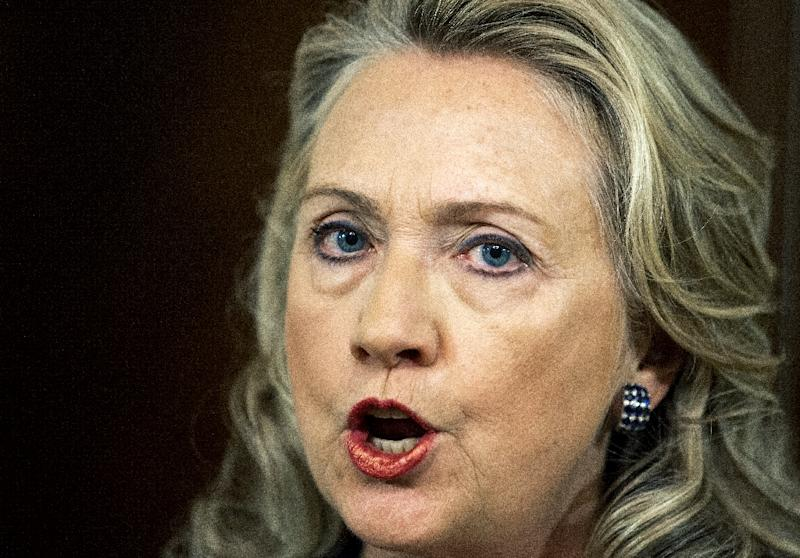 Secretary of State Hillary Clinton delivers a statement in Washington, DC on September 12, 2012 on the killing of US Ambassador to Libya Christopher Stevens and 3 staff members at the US Consulate building in Benghazi, Libya (AFP Photo/Paul J. Richards)