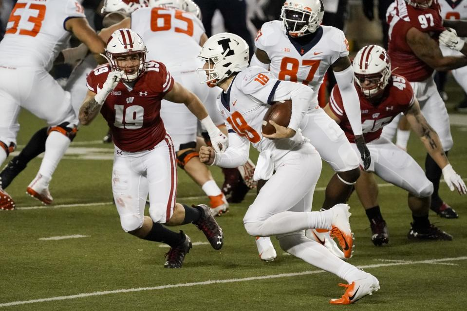 Illinois quarterback Brandon Peters runs during the second half of an NCAA college football game against Wisconsin Friday, Oct. 23, 2020, in Madison, Wis. Wisconsin won 45-7. (AP Photo/Morry Gash)
