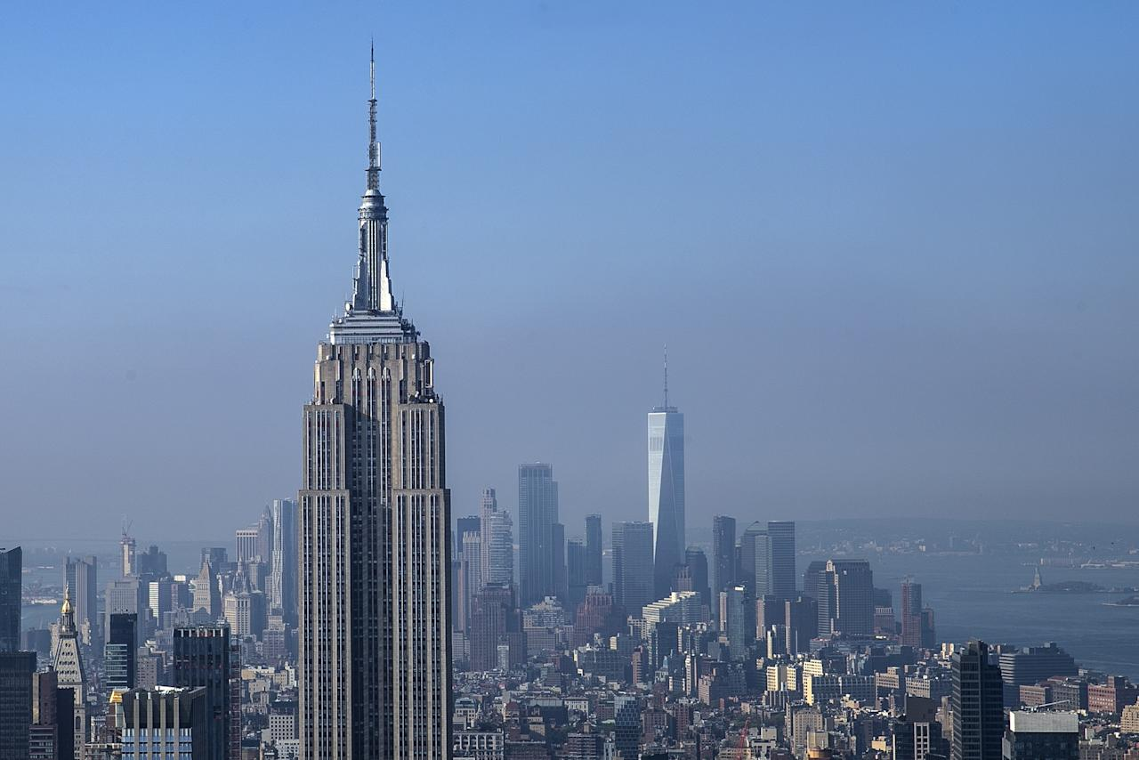 <p>One World Trade Center is seen towering above the landscape in lower Manhattan behind the Empire State Building on Sept. 5, 2018. (Photo: Gordon Donovan/Yahoo News) </p>