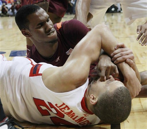 Virginia Tech guard Robert Brown vies for a loose ball with Clemson forward Milton Jennings (24) during the first half of an NCAA college basketball game in the first round of the Atlantic Coast Conference men's tournament, Thursday, March 8, 2012, in Atlanta. (AP Photo/John Bazemore)
