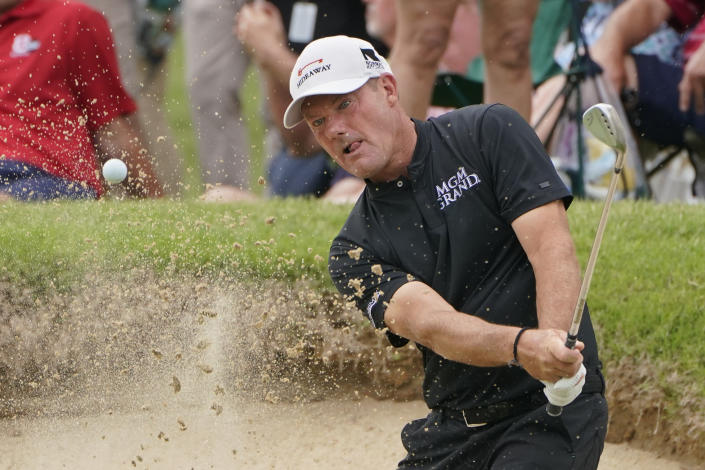 Alex Cejka hits out of the sand on the 16th green in the final round of the Senior PGA Championship golf tournament Sunday, May 30, 2021, in Tulsa, Okla. (AP Photo/Sue Ogrocki)
