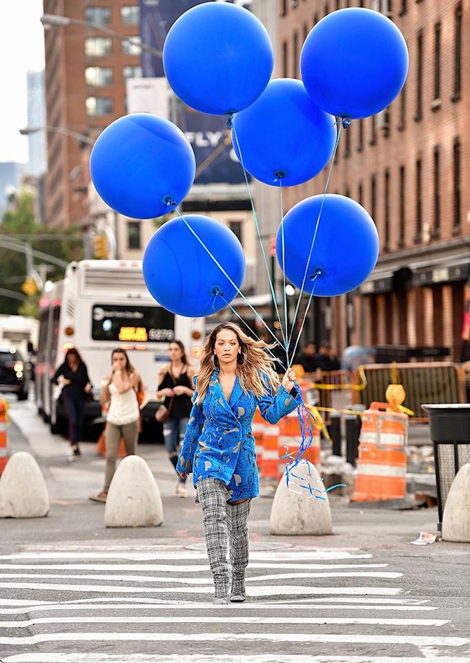<p>Ora and a bunch of balloons made for a pretty picture as she filmed a music video on the streets of New York City. (Photo: James Devaney/GC Images) </p>