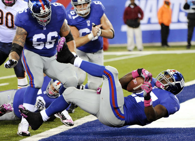 New York Giants running back Brandon Jacobs (27) scores a touchdown during the fourth quarter of an NFL football game against the Chicago Bears at New Meadowlands Stadium, Sunday, Oct. 3, 2010, in East Rutherford, N.J. The Giants won the game 17-3. (AP Photo/Bill Kostroun)