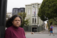 Census taker Linda Rothfield poses across the street from an apartment building she was unable to access in San Francisco, on Wednesday, June 30, 2021. Some census takers worry that renters in apartment buildings were not tallied fully during the nation's head count last year. Census takers say they had difficulty entering apartment buildings due to COVID restrictions, and they weren't able to get in touch with landlords for help. (AP Photo/Eric Risberg)