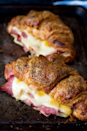 """<p>A basic ham and cheese sandwich gets a major upgrade, topped with poppy seeds, honey, and mustard. </p><p><strong>Get the recipe at <a href=""""http://kitchensanctuary.com/2016/03/ham-cheese-croissants-honey-mustard-glaze/"""" rel=""""nofollow noopener"""" target=""""_blank"""" data-ylk=""""slk:Kitchen Sanctuary"""" class=""""link rapid-noclick-resp"""">Kitchen Sanctuary</a>.</strong> </p>"""
