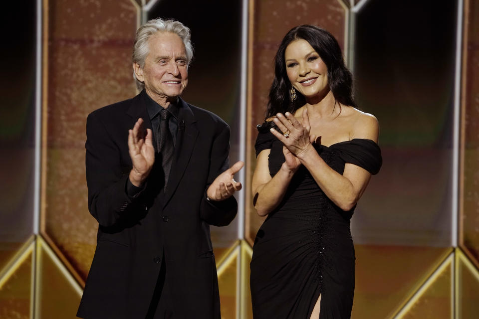 Michael Douglas and Catherine Zeta-Jones speak onstage at the 78th Annual Golden Globe Awards held at The Rainbow Room and broadcast on February 28, 2021 in New York, New York.