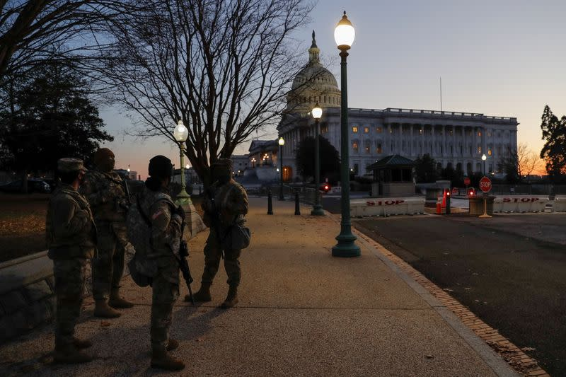 U.S. National Guard members stand near the U.S. Capitol Building on Capitol Hill in Washington