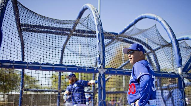 <p>Keeping an eye on Justin Turner's swing in the cage...</p>