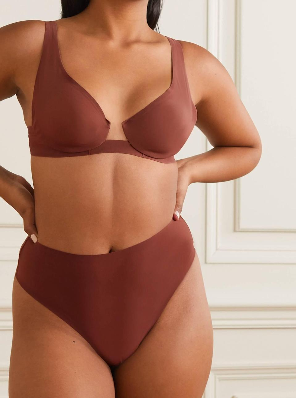 """Skims' shapewear is exactly what you need for that dreamy <a href=""""https://www.glamour.com/gallery/best-linen-dresses-to-shop-now?mbid=synd_yahoo_rss"""" rel=""""nofollow noopener"""" target=""""_blank"""" data-ylk=""""slk:linen dress"""" class=""""link rapid-noclick-resp"""">linen dress</a> hanging in your closet. This no-show thong sits high up on the hips for support and full coverage around the waist. $28, Net-a-Porter. <a href=""""https://www.net-a-porter.com/en-us/shop/product/skims/lingerie/thongs/naked-high-waisted-thong-jasper/25372685655714047"""" rel=""""nofollow noopener"""" target=""""_blank"""" data-ylk=""""slk:Get it now!"""" class=""""link rapid-noclick-resp"""">Get it now!</a>"""