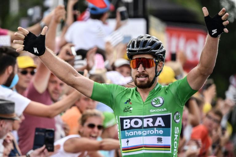 Slovakian Peter Sagan raises his arms in triumph at the end of stage five on the Tour de France