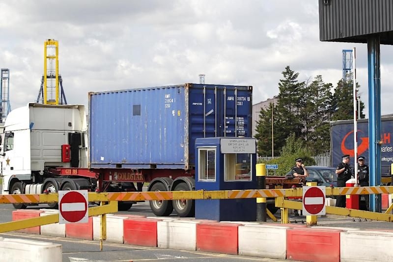 View of an entrance to Tilbury Docks, east of London on August 16, 2014, where one man was found dead and 34 people alive in a shipping container