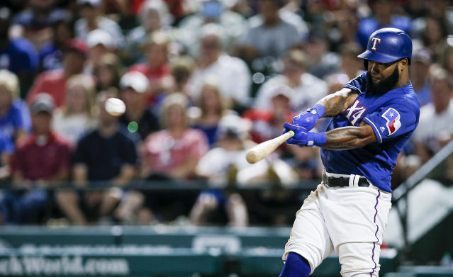 Texas Rangers' Danny Santana makes contact for a walkoff single during the ninth inning of a baseball game against the Houston Astros, Friday, July 12, 2019, in Arlington, Texas. (AP Photo/Brandon Wade)