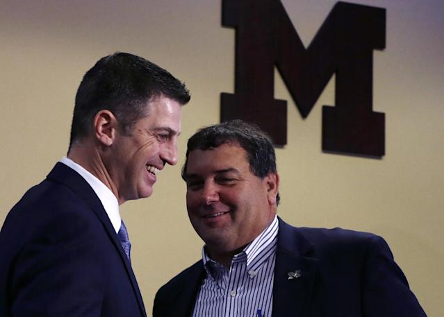 Doug Nussmeier, left, stands with head coach Brady Hoke after being introduced as Michigan's NCAAA college football offensive coordinator and quarterbacks coach during a news conference at the Junge Center in Ann Arbor, Mich., Friday, Jan. 10, 2014. Nussmeier is the former Alabama offensive coordinator. (AP Photo/Carlos Osorio)