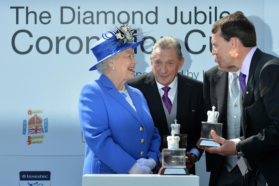 EPSOM, ENGLAND - JUNE 02:  Queen Elizabeth II (L) presents the trophy to Aidan O'Brien (R), the trainer of St Nicholas Abbey, after his horse won the Diamond Jubilee Coronation Cup on Derby Day on June 2, 2012 in Epsom, England. For only the second time in its history, the UK celebrates the Diamond Jubilee of a monarch. Her Majesty Queen Elizabeth II celebrates the 60th anniversary of her ascension to the throne. The Queen along with all the members of the royal family will participate in a River Pageant with a flotilla of 1,000 boats accompanying them down the Thames, a star studded free concert at Buckingham Palace, and a carriage procession and a Service of Thanksgiving at St Paul's Cathedral.  (Photo by Ben Stansall - WPA Pool /Getty Images)