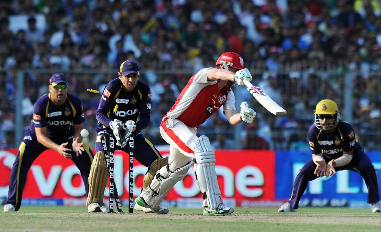 Kings XI Punjab batsman Shaun Marsh (2R) is clean bowled as Kolkata Knight Riders wicketkeeper Manvinder Bisla (2L) looks on during the IPL Twenty20 cricket match between Kolkata Knight Riders and Kings XI Punjab at The Eden Gardens in Kolkata on April 15, 2012. RESTRICTED TO EDITORIAL USE. MOBILE USE WITHIN NEWS PACKAGE. AFP PHOTO/Dibyangshu SARKAR (Photo credit should read DIBYANGSHU SARKAR/AFP/Getty Images)