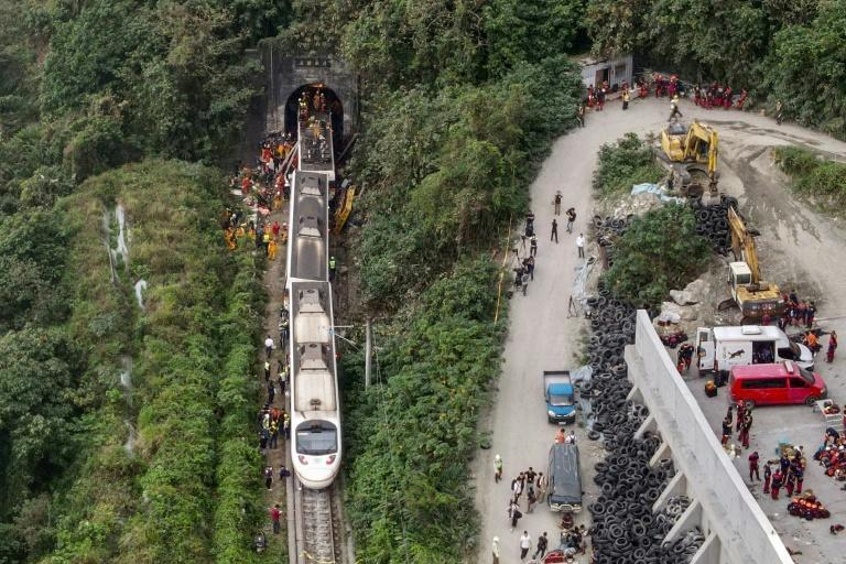 The crash, which killed at least 50 people and injured more than 170, was caused by a collision with a vehicle that slipped onto the tracks just as the train went into a narrow tunnel near the eastern coastal city of Hualien
