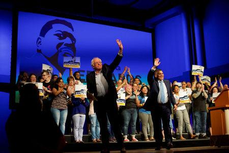 FILE PHOTO: (L-R) U.S. Senator Bernie Sanders and Democrat Greg Edwards, Pennsylvania's 7th District Congressional candidate, wave to supporters during a rally in Allentown, Pennsylvania, U.S. May 5, 2018.  REUTERS/Mark Makela
