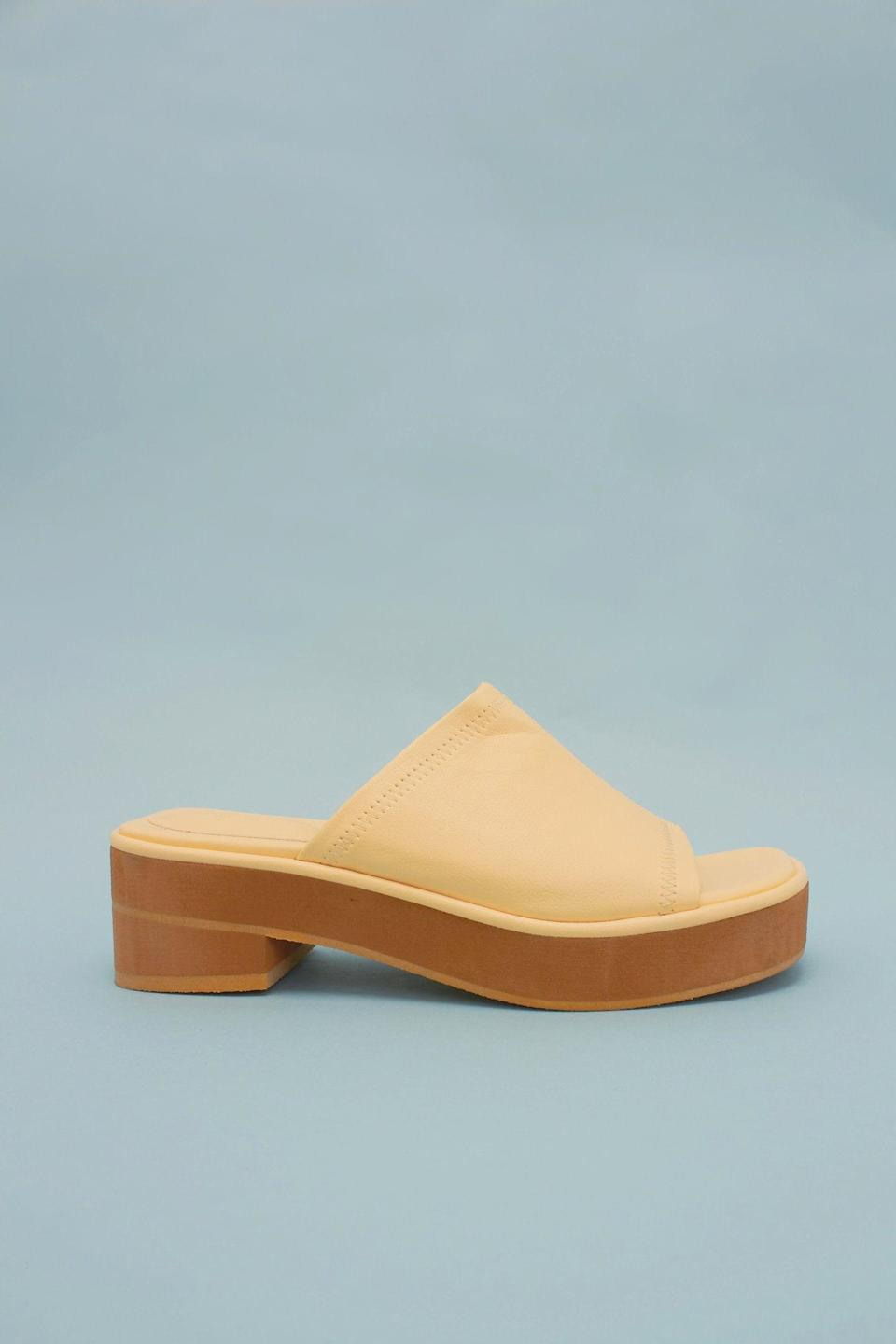 """<br> <br> <strong>The Source Unknown</strong> Slide Sandals, $, available at <a href=""""https://go.skimresources.com/?id=30283X879131&url=https%3A%2F%2Fthesourceunknown.com%2Fcollections%2Fshoes-bags%2Fproducts%2Fslide-sandals-butter"""" rel=""""nofollow noopener"""" target=""""_blank"""" data-ylk=""""slk:The Source Unknown"""" class=""""link rapid-noclick-resp"""">The Source Unknown</a>"""