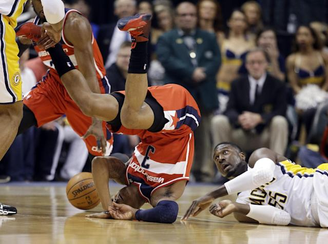 Indiana Pacers center Roy Hibbert, right, lies on the court as Washington Wizards guard Bradley Beal flips over while they go for a loose ball during the first half of game 2 of the Eastern Conference semifinal NBA basketball playoff series Wednesday, May 7, 2014, in Indianapolis. (AP Photo/Darron Cummings)