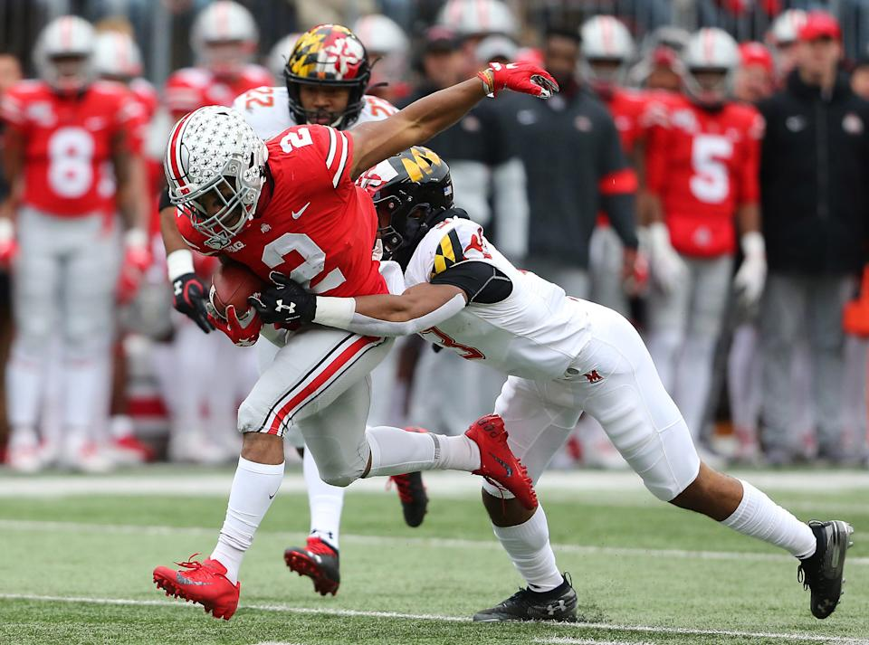 Ohio State running back J.K. Dobbins  tackled by Maryland defensive back Nick Cross during the first quarter at Ohio Stadium.