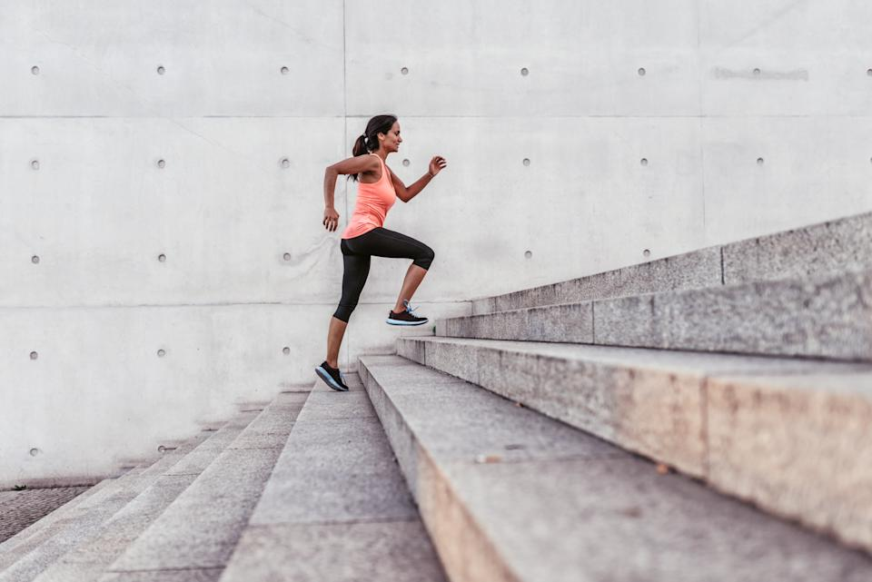 Woman exercising by running up stairs