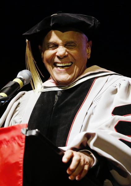 Harry Belafonte laughs while speaking after receiving an honorary doctor of music from Berklee College of Music at the Berklee Performance Center in Boston, Thursday, March 6, 2014. (AP Photo/Michael Dwyer)