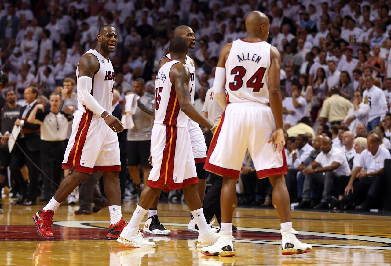 MIAMI, FL - JUNE 18:  LeBron James #6, Mario Chalmers #15, Chris Bosh #1 and Ray Allen #34 of the Miami Heat celebrate in the fourth quarter while taking on the San Antonio Spurs during Game Six of the 2013 NBA Finals at AmericanAirlines Arena on June 18, 2013 in Miami, Florida. NOTE TO USER: User expressly acknowledges and agrees that, by downloading and or using this photograph, User is consenting to the terms and conditions of the Getty Images License Agreement.  (Photo by Mike Ehrmann/Getty Images)