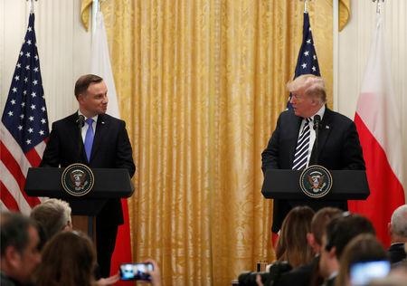 U.S. President Donald Trump arrives for a joint news conference with Poland's President Andrzej Duda in the East Room of the White House in Washington, U.S., September 18, 2018. REUTERS/Kevin Lamarque
