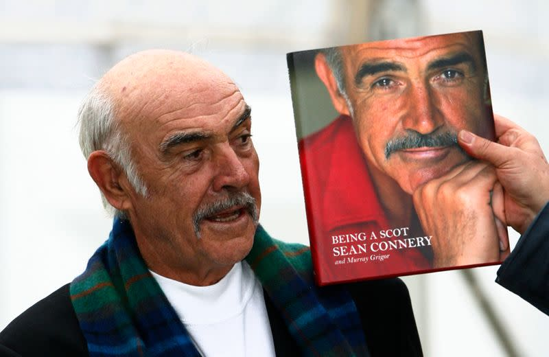 """FILE PHOTO: Sean Connery stands next to a copy of his new autobiography """"Being A Scot"""" during a photocall for its launch at the Edinburgh International Book Festival"""
