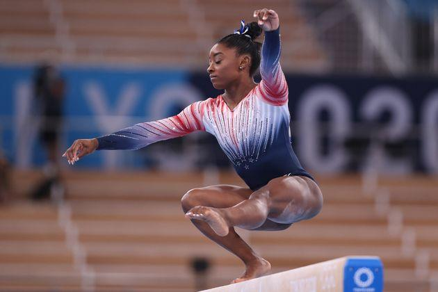 Simone Biles competes in the women's balance beam final on day 11 of the Tokyo 2020 Olympic Games. (Photo: Elsa via Getty Images)
