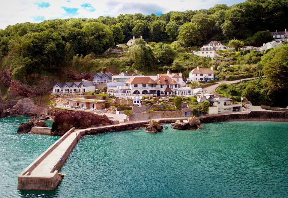 """<p>Cary Arms has rightly built a reputation as one of south Devon's most picturesque and luxurious hotels. Perched at the bottom of a steep cliff, it sits at the foot of Babbacombe Downs overlooking the beach and surrounding bay which, on a sunny day, could easily be mistaken for a Croatian island or an undiscovered part of Greece. Shrubs and foliage grow from the cliffs, giving way to perfectly clear blue waters ideal for a swim. Book a room at the hotel itself, or if you're looking for a more secluded option then choose one of its private cottages which come in varying sizes. We stayed at Foxes Walk, which sleeps nine, a three-floor property with ocean views, an expansive kitchen, a cosy living room and dining room with a woodburner for warming nights in, and a beautifully landscaped garden complete with sun loungers and a hot tub, again with ocean vistas. The thoughtful touches, from baskets full of snacks and a bottle of sloe gin to beach towels left in the conservatory and bath products from The White Company, will ensure you feel at home almost immediately. The pub offers delicious elevated takes on British classics, while the spa - nestled into the cliff face - boasts an indoor pool with floor-to-ceiling windows from which to look out to sea. Make sure you book a treatment (we can recommend the body massage) for guaranteed shoulder-dropping relaxation. For the boat experience of a lifetime, you can board the 1930s hand-built yacht 'Escape'. In the capable hands of captain Andy, you'll set sail on a tour of the dramatic coastline of the English Riviera. </p><p><a href=""""https://www.caryarms.co.uk/"""" rel=""""nofollow noopener"""" target=""""_blank"""" data-ylk=""""slk:Cary Arms & Spa"""" class=""""link rapid-noclick-resp"""">Cary Arms & Spa</a>, prices start at Foxes Walk at £495 per night. </p>"""