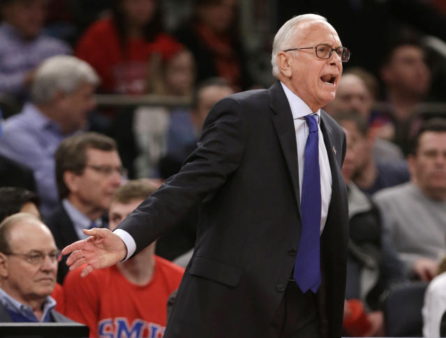 SMU coach Larry Brown calls out to his team during the first half of an NCAA college basketball game against Minnesota in the final of the NIT on Thursday, April 3, 2014, in New York. (AP Photo/Frank Franklin II)