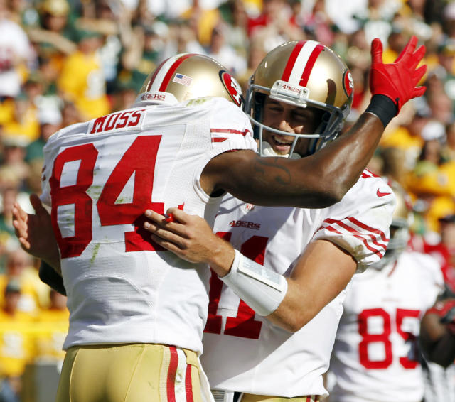 San Francisco 49ers' Randy Moss (84) is congratulated by quarterback Alex Smith (11) after Moss caught a touchdown pass during the first half of an NFL football game against the Green Bay Packers Sunday, Sept. 9, 2012, in Green Bay, Wis. (AP Photo/Mike Roemer)
