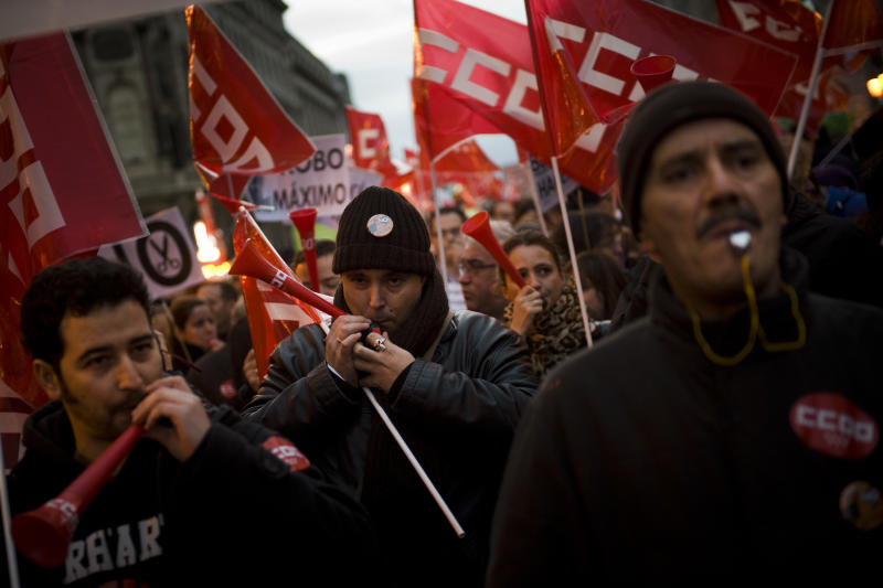 People blow whistles and horns during a demonstration against job cuts at  bailed-out bank Bankia in Madrid Wednesday Jan. 23, 2013. Spain's recession deepened in the fourth quarter of 2012, when the economy shrank by 0.6 percent compared with the previous three-month period, according to preliminary estimates from the Bank of Spain on Wednesday.(AP Photo/Daniel Ochoa de Olza)